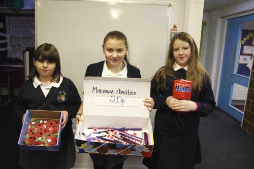 Year 6 children selling poppies and merchandise