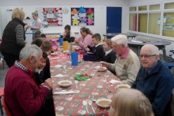 Elderly residents join Bells Farm children for Christmas lunch