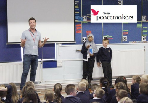Phil taking a school assembly introducing Peacemakers to the children