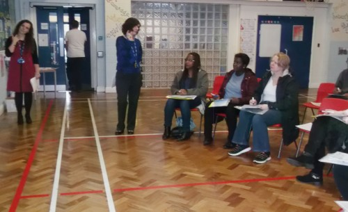 Parents and carers attend a phonics workshop