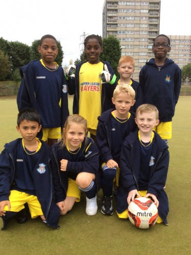 The Year 3 and Year 4 mixed football team